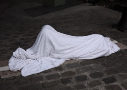 The MIgrants, 2009: This series was made in Paris, early in the morning, by Villemin Square, where many Afghan migrants gather. Invisible, silent and anonymous, reduced to their simple forms, they sleep and hide themselves from the public gaze, withdrawing from a world which no longer wants to see them. Both present and absent, they remind us of the bodies found on the battlefields of war we no longer see.