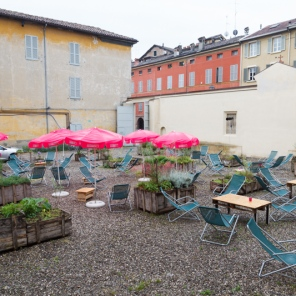 Fotografia Europea, Reggio Emilia, Italy, May 2014: The courtyard near the ticket office begs for visitors who for now, are choosing to stay out of the rain.