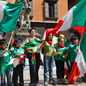 Welcome to Reggio Emilia, Italy, May 2014: Children perform in the Piazza Prampolini near the Duomo.